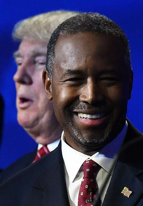 Republican Presidential hopefuls Donald Trump (L), and Ben Carson look on during a break in the CNBC Republican Presidential Debate, October 28, 2015. Photo: Robyn Beck, AFP / Getty Images