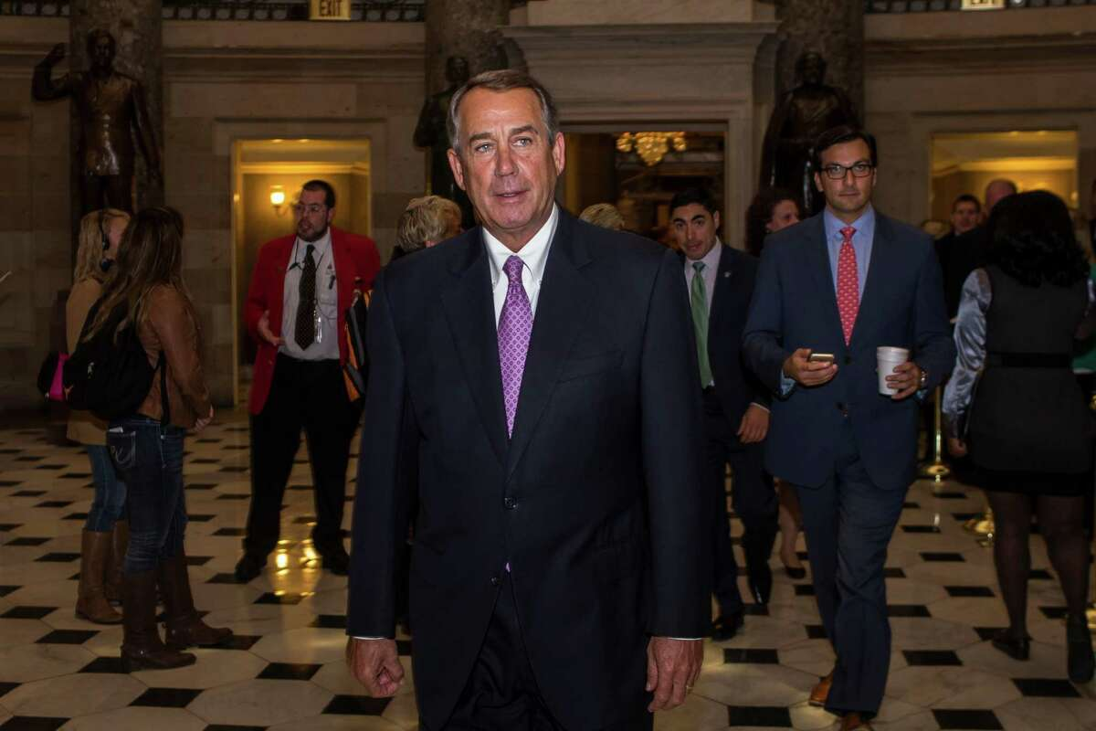 House Speaker John Boehner (R-Ohio) walks through on Capitol Hill in Washington, Oct. 28, 2015. The ouster of Boehner as speaker helped clear the way for a bipartisan budget deal that avoided a government shutdown. (Zach Gibson/The New York Times)
