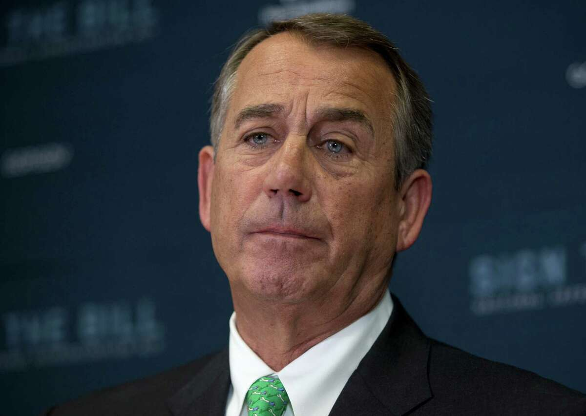 FILE - In this Oct. 21, 2015 file photo, House Speaker John Boehner of Ohio pauses during a news conference on Capitol Hill in Washington. Boehner may not be popular enough with House Republicans to keep his job, but he has a lot of admirers on Capitol Hill _ many of whom stood in a long line to get a last photo with him Friday. (AP Photo/Carolyn Kaster, File)