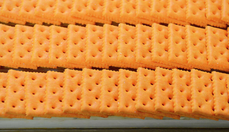 Crackers move on the Toast Chee production line in Charlotte, N.C. Snyder's-Lance expects annual cost savings of $75 million from its Diamond Foods deal. Photo: John D. Simmons, MBI / The Charlotte Observer