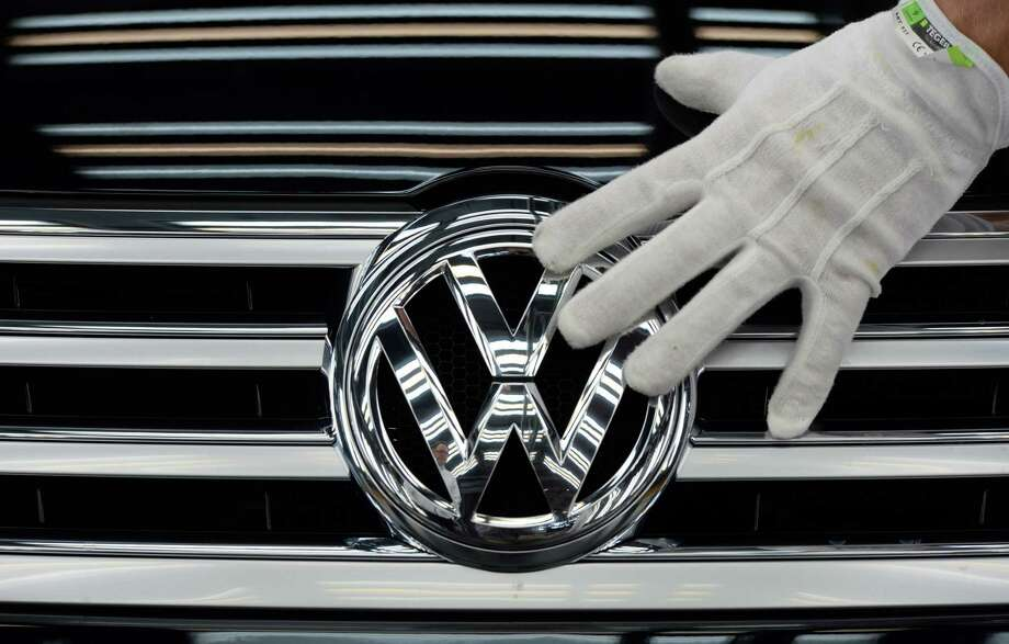 Volkswagen CEO Matthias Mueller has raised the possibility of job cuts because of the cost of the scandal. VW employs 614,000 worldwide. Photo: Ralf Hirschberger, SUB / dpa