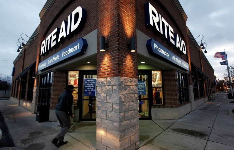 Rite Aid's combination with Walgreens would create a drugstore behemoth that runs more than 12,700 stores in the United States. Photo: Paul Sancya, STF / AP