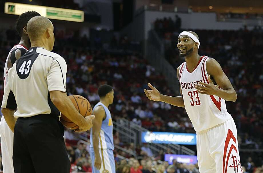 Houston Rockets guard Corey Brewer right, reacts after being called for a foul during the second half of NBA game action at the Toyota Center Wednesday, Oct. 28, 2015, in Houston.  ( James Nielsen / Houston Chronicle ) Photo: Houston Chronicle