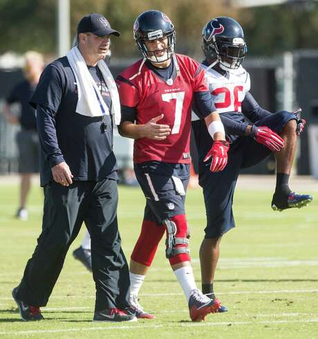 Bill O'Brien, left, tries working his coaching magic on Brian Hoyer, who will see sideline duty Sunday. Photo: Brett Coomer, Staff / © 2015  Houston Chronicle