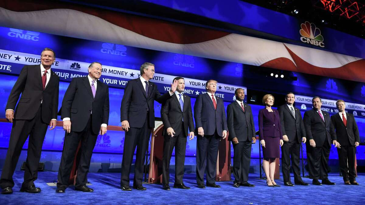 Republican presidential hopefuls John Kasich (from left), Mike Huckabee, Jeb Bush, Marco Rubio, Donald Trump, Ben Carson, Carly Fiorina, Ted Cruz, Chris Christie and Rand Paul take the stage before the start of debate at the University of Colorado.