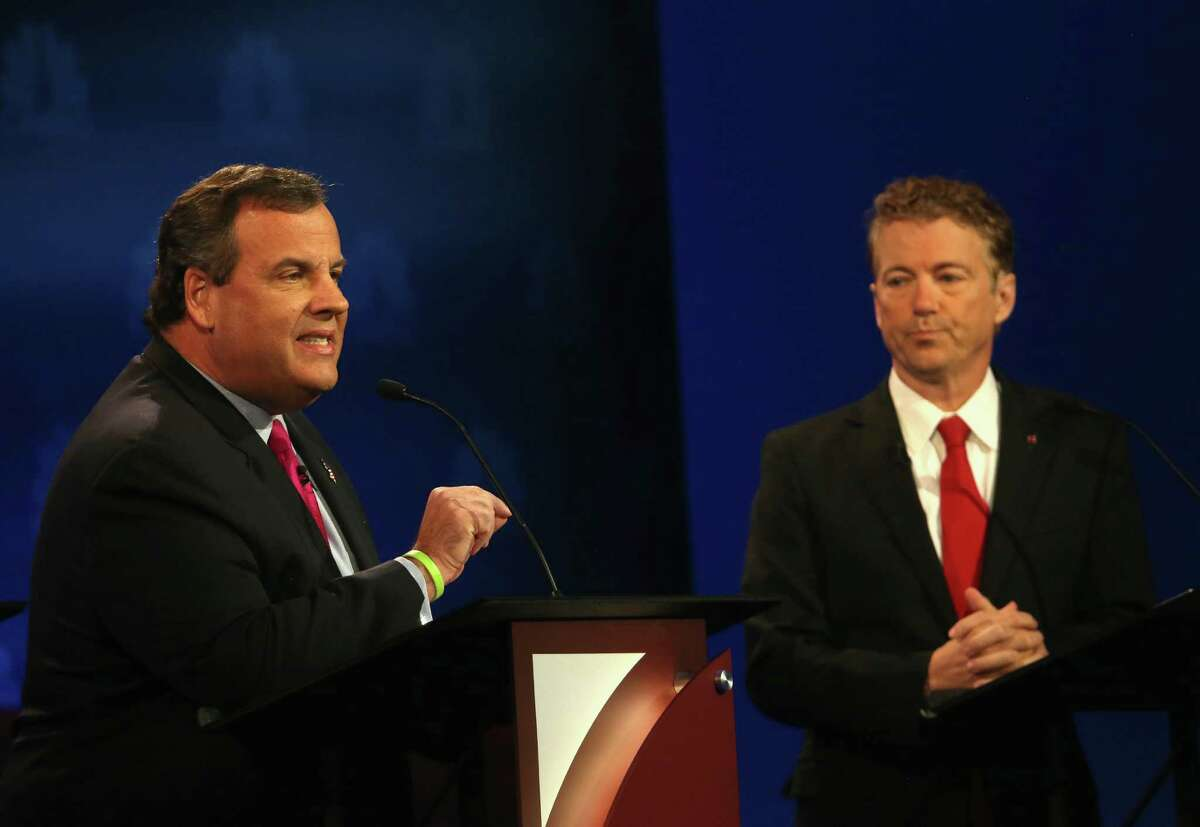 BOULDER, CO - OCTOBER 28: Presidential candidate New Jersey Gov. Chris Christie (L) speaks while Sen. Rand Paul (R-KY) looks on during the CNBC Republican Presidential Debate at University of Colorados Coors Events Center October 28, 2015 in Boulder, Colorado. Fourteen Republican presidential candidates are participating in the third set of Republican presidential debates. (Photo by Justin Sullivan/Getty Images)