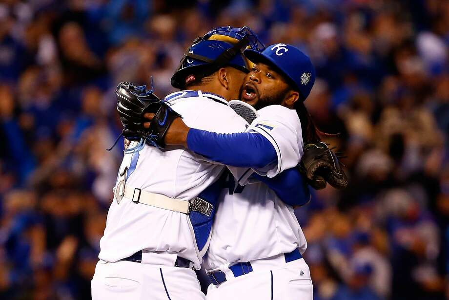 Johnny Cueto, hugging catcher Salvador Perez after winning Game 2 of the 2015 World Series for the Royals, pitched through October, as Giants pitchers did in 2010, 2012 and 2014. Photo: Jamie Squire, Getty Images