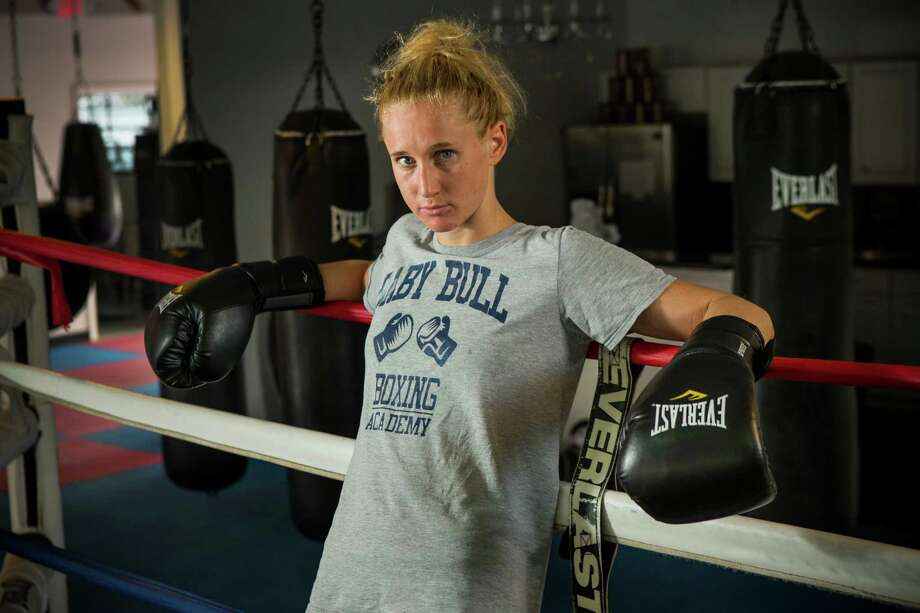 Ginny Fuch poses for a portrait at Baby Bull Boxing Academy on Wednesday, Oct. 21, 2015, in Houston. Fuch is training for a shot at the 2016 Olympics at the upcoming trials. ( Brett Coomer / Houston Chronicle ) Photo: Brett Coomer, Staff / © 2015 Houston Chronicle