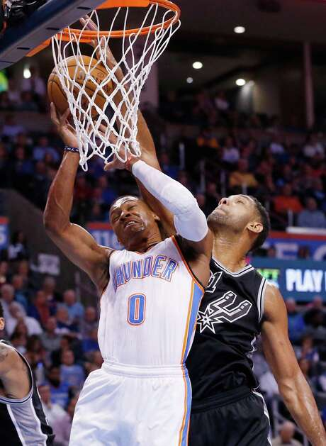 The Spurs' Tim Duncan, right, blocks a shot by the Thunder's Russell Westbrook. Photo: Sue Ogrocki, STF / AP