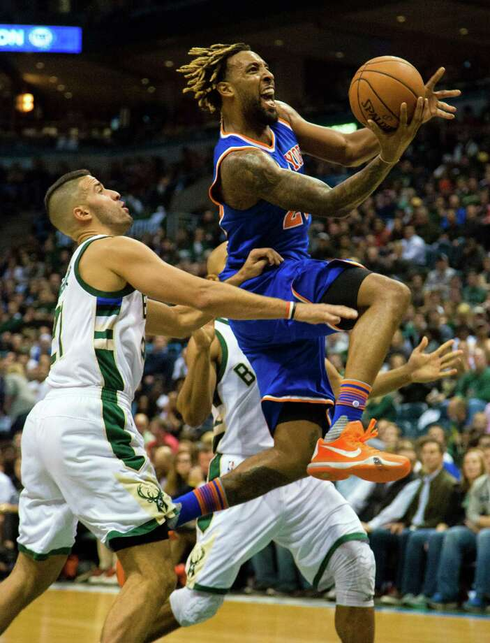 New York Knicks forward Derrick Williams, right, goes up for a basket against Milwaukee Bucks' Greivis Vasquez during the first half of a NBA basketball game Wednesday, Oct. 28, 2015, in Milwaukee. (AP Photo/Darren Hauck) ORG XMIT: WIDH107 Photo: Darren Hauck / FR81528 AP