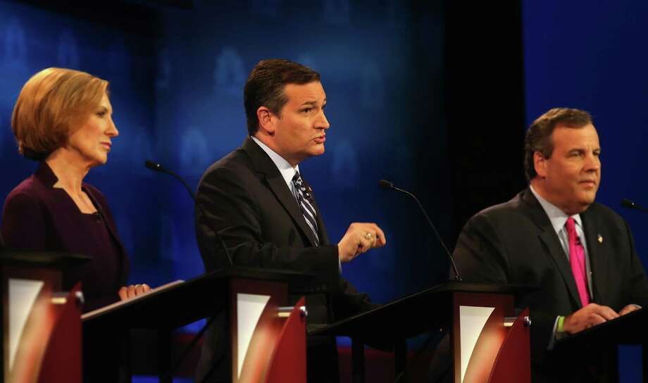 Sen. Ted Cruz, center, used Wednesday's debate to trash the media and a bipartisan budget deal that passed the House earlier in the day. He is flanked by Carly Fiorina and New Jersey Gov.  Chris Christie. Photo: Justin Sullivan, Staff / 2015 Getty Images