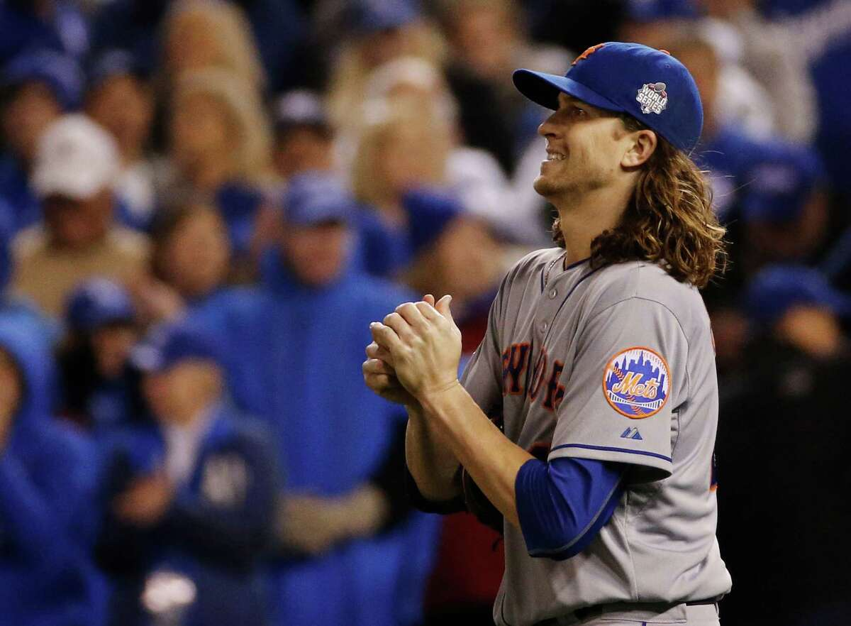 New York Mets pitcher Jacob deGrom looks at the scoreboard after giving up an RBI single to Kansas City Royals' Alcides Escobar during the fifth inning of Game 2 of the Major League Baseball World Series Wednesday, Oct. 28, 2015, in Kansas City, Mo. (AP Photo/Matt Slocum) ORG XMIT: WS120