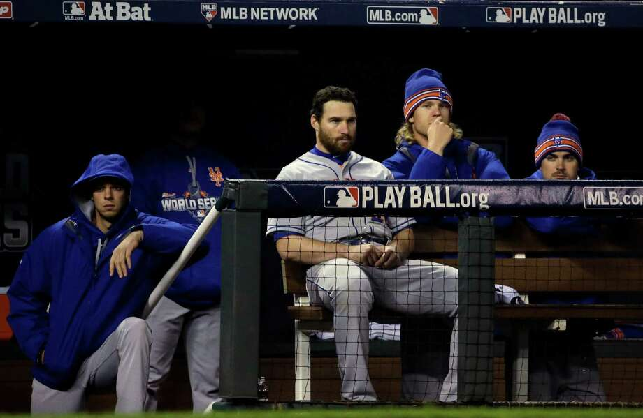 Some New York Mets watch from the dugout during the eighth inning of Game 2 of the Major League Baseball World Series against the Kansas City Royals Wednesday, Oct. 28, 2015, in Kansas City, Mo. (AP Photo/David J. Phillip) ORG XMIT: WS555 Photo: David J. Phillip / AP