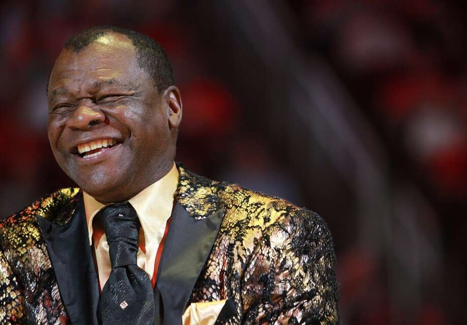 Calvin Murphy smiles during a tribute to former Rocket Moses Malone during halftime of Houston's game against the Denver Nuggets, Wednesday, Oct. 28, 2015, in Houston.( Mark Mulligan / Houston Chronicle ) Photo: Houston Chronicle