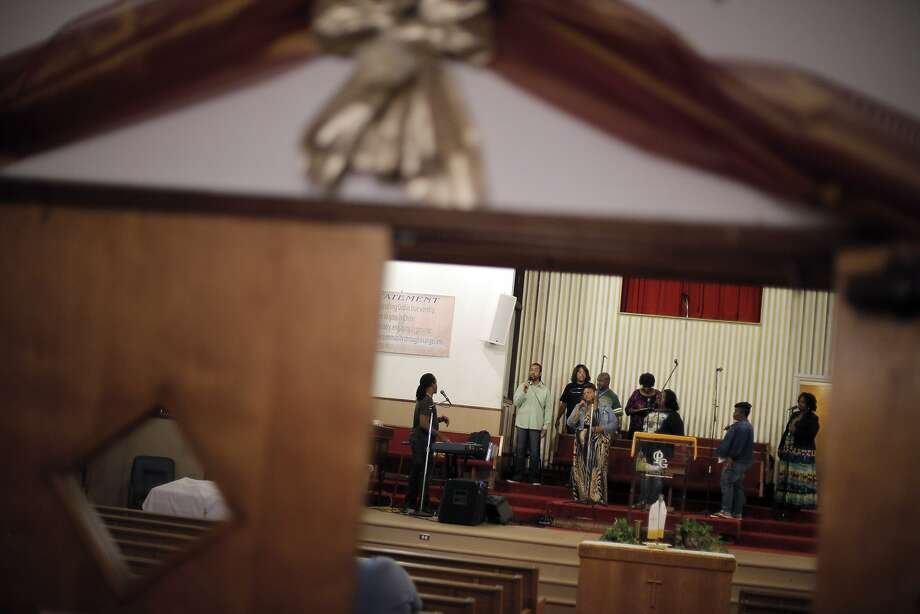 Ron Rosson, associate pastor and music minister at Pleasant Grove Baptist Church in Oakland, leads choir members during rehearsal Wednesday. The church was facing a fine over a neighbor's complaint of loud music. Photo: Carlos Avila Gonzalez, The Chronicle