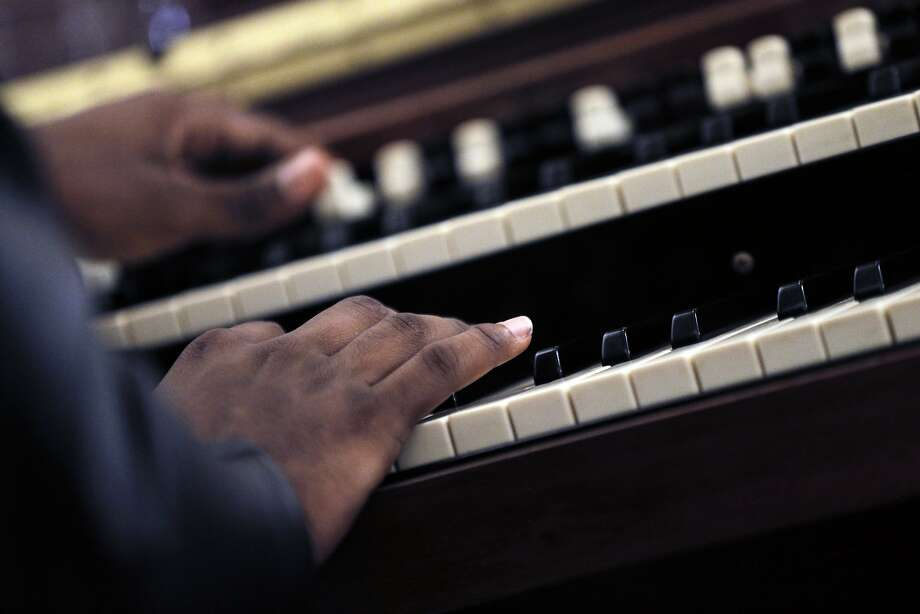 Ron Rosson Jr. plays the organ during choir rehearsal. Photo: Carlos Avila Gonzalez, The Chronicle