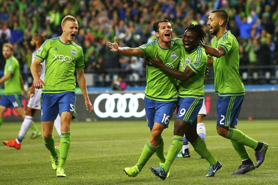 Seattle's Nelson Valdez (16) celebrates with teammates Obafemi Martins (9), Andy Rose (5) and Clint Dempsey (2) after Valdez scored a goal against Los Angeles in the first half  of their MLS soccer western conference knockout round playoff match, Wednesday, Oct. 28, 2015 at CenturyLink Field. Photo: GENNA MARTIN, SEATTLEPI.COM / SEATTLEPI.COM
