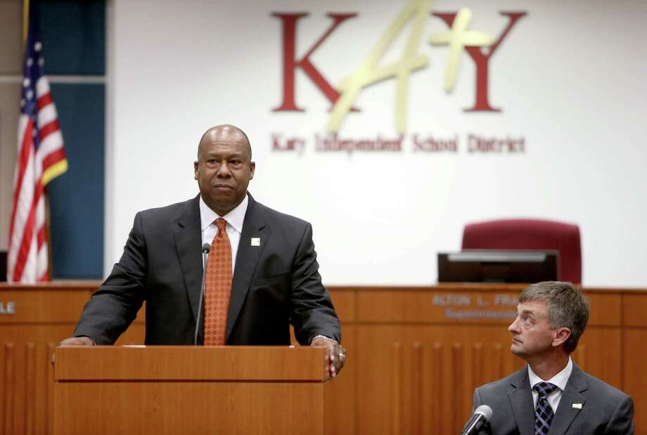 Alton Frailey, superintendent Katy Independent School District (KISD), shown with Charles Griffin, board president KISD, answers questions from the media at a press conference discussing a West Memorial Junior High parent's concern over a classroom activity they felt questioned student's religious beliefs, held at the school district's Education Support Complex Wednesday, Oct. 28, 2015, in Katy, Texas. Photo: Gary Coronado, Houston Chronicle / © 2015 Houston Chronicle