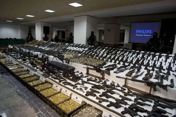 View of cartridges and weapons seized to gangsters and drug-traffickers at the Military Headquarter in Mexico City, on November 7, 2008. The Mexican army made the country's largest ever weapons haul, of 540 weapons, from three suspected members of the powerful Gulf drug cartel, defense officials said. Mexican officials have urged the United States for years to enact the type of gun control proposed by President Barack Obama, arguing that drug gangs were using US-made assault rifles in brutal turf wars. Analysts, however, say the measures unveiled on January 16, 2013 would do little to stem Mexico's wave of gangland killings for now, since drug cartels have built an arsenal of military-style guns to outgun local police.  AFP PHOTO/MicphotoPress/Fernando CastilloFernan Castillo/AFP/Getty Images