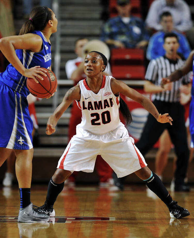 Lamar's senior guard JaMeisha Edwards, who was voted first team on the preseason Southland Conference team, is a major reason why the Lady Cardinals were picked as the favorites to win the conference title. New Orleans' Danielle Davis, No. 32, looks for an open teammate while Lamar's JaMeisha Edwards, No. 20, delays her pass. Lamar University played against the University of New Orleans at the Montagne Center on Thursday night. Photo taken Thursday, 3/6/14 Jake Daniels/@JakeD_in_SETX   Manditory Credit, No Sales, Mags Out, TV OUT, Web: AP Members Only Photo: Jake Daniels / ©2014 The Beaumont Enterprise/Jake Daniels