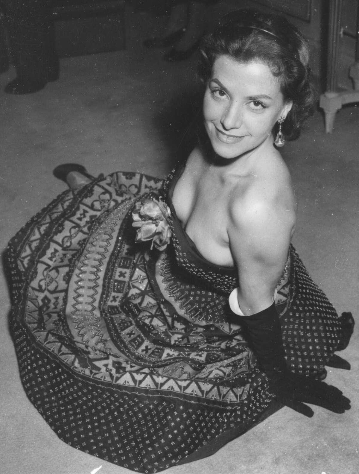 Brazilian actress Vera Clouzot wearing a hand-beaded short silk evening dress designed by Christian Dior, in 1954.