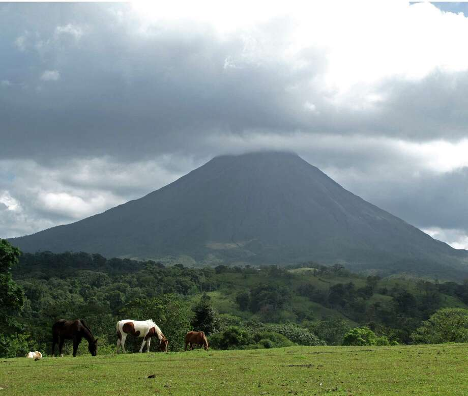 The Arenal Volcano, perhaps one of Costa Rica's most notable topographical features, is surrounded by a national park and is near rural tourism sites as well as spots for zip lining, whitewater rafting and soaking in the hot springs. (Terri Colby/Chicago Tribune/TNS) Photo: Terri Colby, MBR / Chicago Tribune