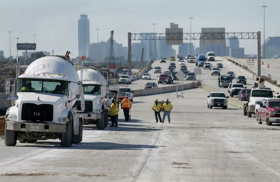 Construction workers put the finishing touches on where the Loop 610 northbound traffic will connect to the new eastbound bridge on Oct. 28. Traffic will shift over the weekend. Photo: Melissa Phillip, Houston Chronicle / © 2015 Houston Chronicle