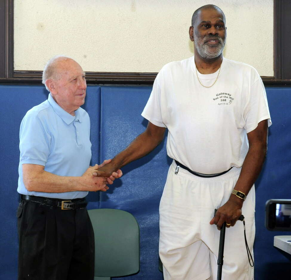 Former NBA player Luther (Ticky) Burden, an Albany native, talks about his high school basketball coach Ron Sontz, left, while visiting Trinity Alliance on Friday, June 21, 2013 in Albany, N.Y. (Lori Van Buren / Times Union)