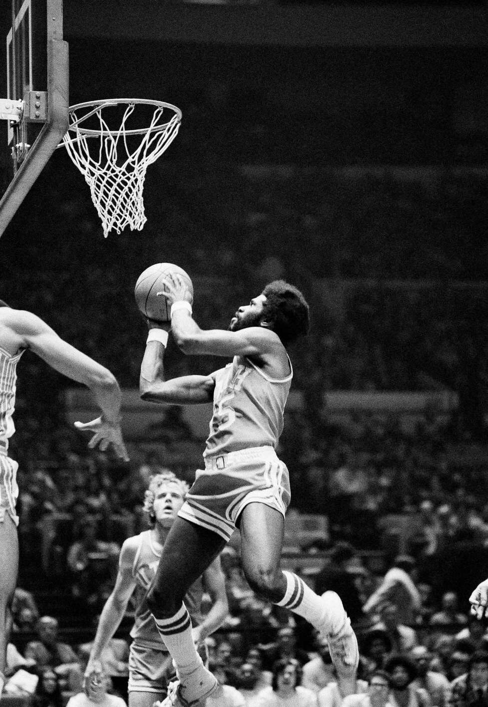 Utah's Ticky Burden goes into action with the ball Sunday in the first game of the National Invitational Tournament, March 17, 1974 at Madison Square Garden in New York City. Burden scored 34 points as Utah held off a second-half rally and defeated Rutgers 102-89. (AP Photo/Ray Stubblebine)