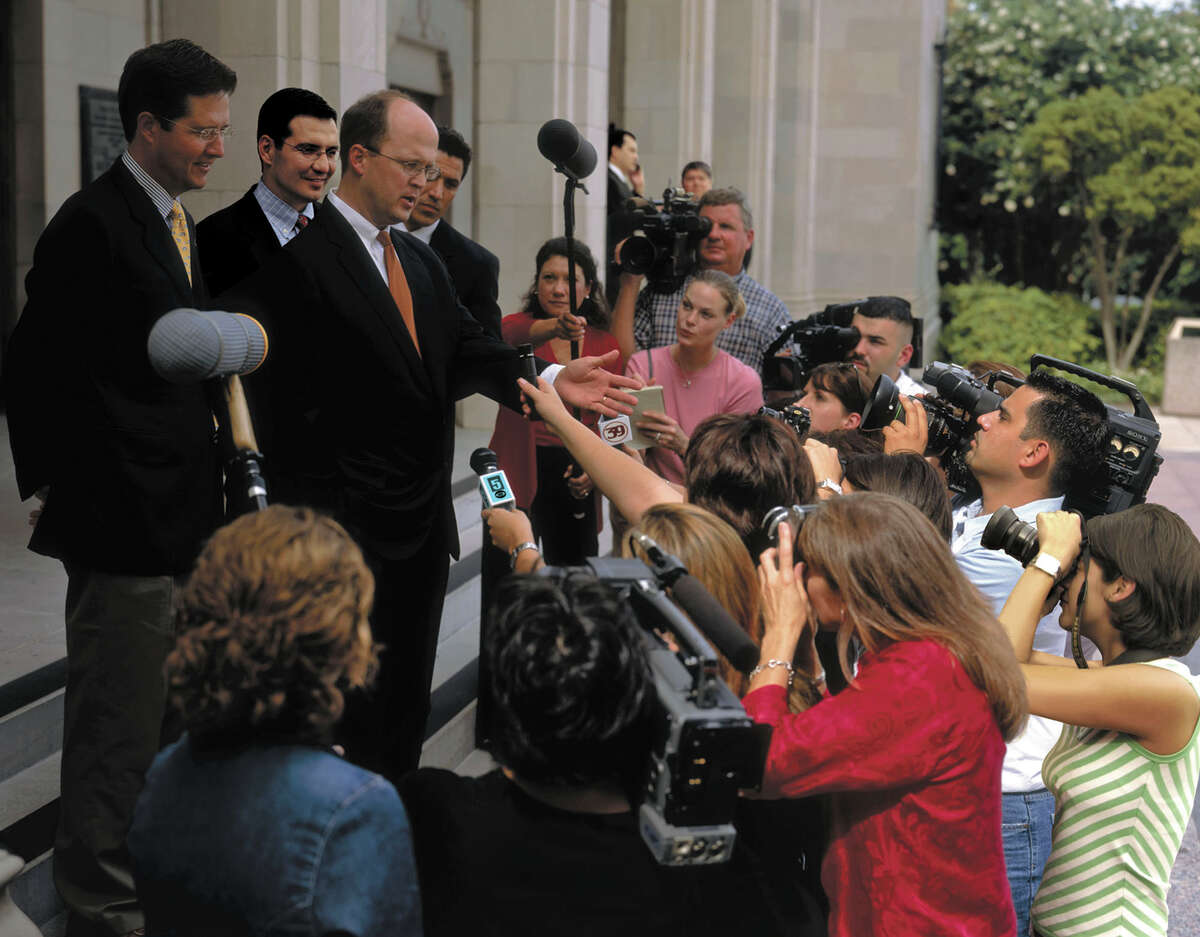 Lawyer Mikal Watts, center, talks with reporters in 2005 about a legal battle with Ford Motor Company over allegedly defective products. Watts, a San Antonio personal injury lawyer and well-known Democratic supporter, was indicted Thursday by a federal grand jury that he committed identity theft by filing bogus claims for nonexistent clients in BP oil spill litigation.