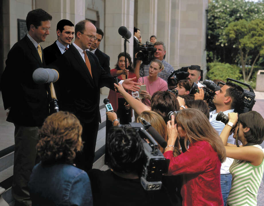 Lawyer Mikal Watts, center, talks with reporters in 2005 about a legal battle with Ford Motor Company over allegedly defective products. Watts, a San Antonio personal injury lawyer and well-known Democratic supporter, was indicted Thursday by a federal grand jury that he committed identity theft by filing bogus claims for nonexistent clients in BP oil spill litigation. Photo: /COURTESY PHOTO