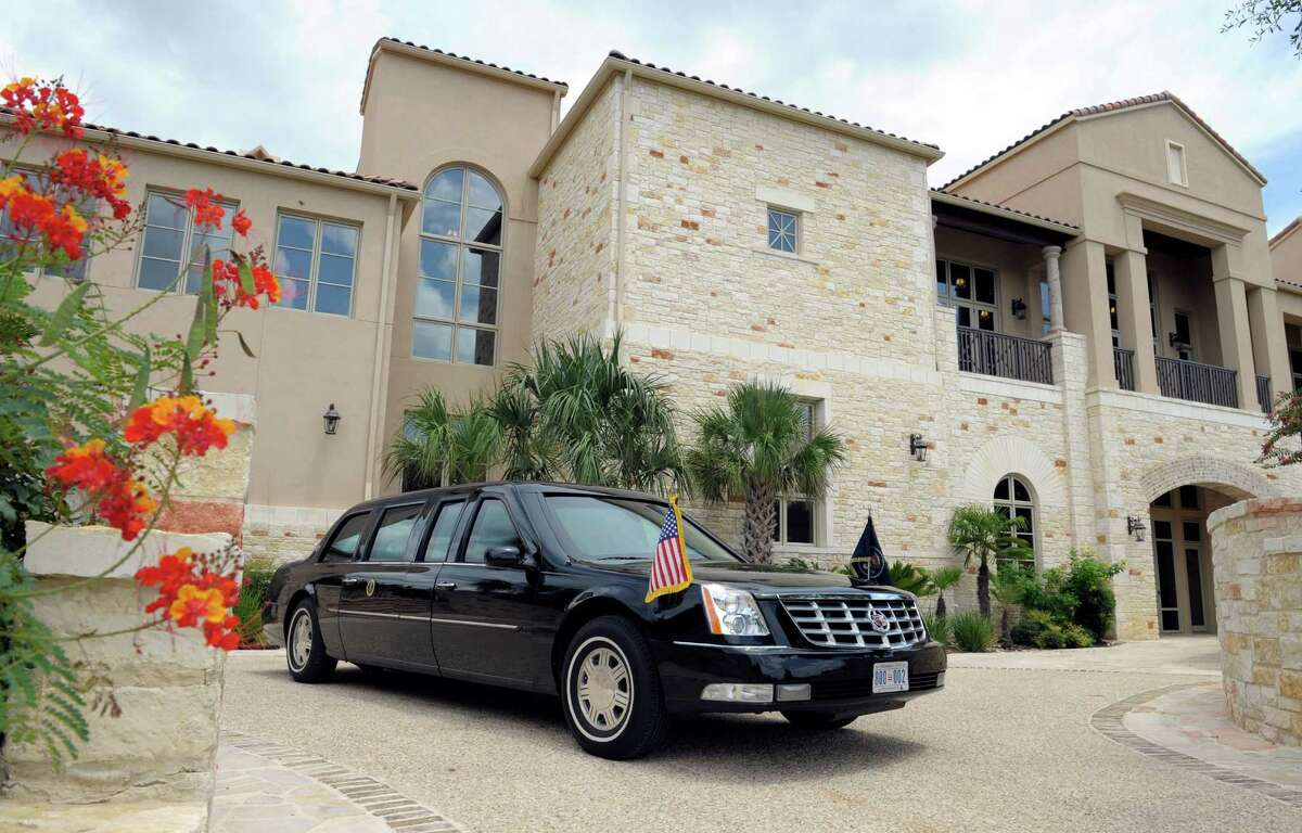 The limousine for President Barack Obama sits in the driveway of the home of Mikal Watts, a trial lawyer, in San Antonio in the summer of 2012. Obama, who is at the Watts' home, was spending the day fundraising.