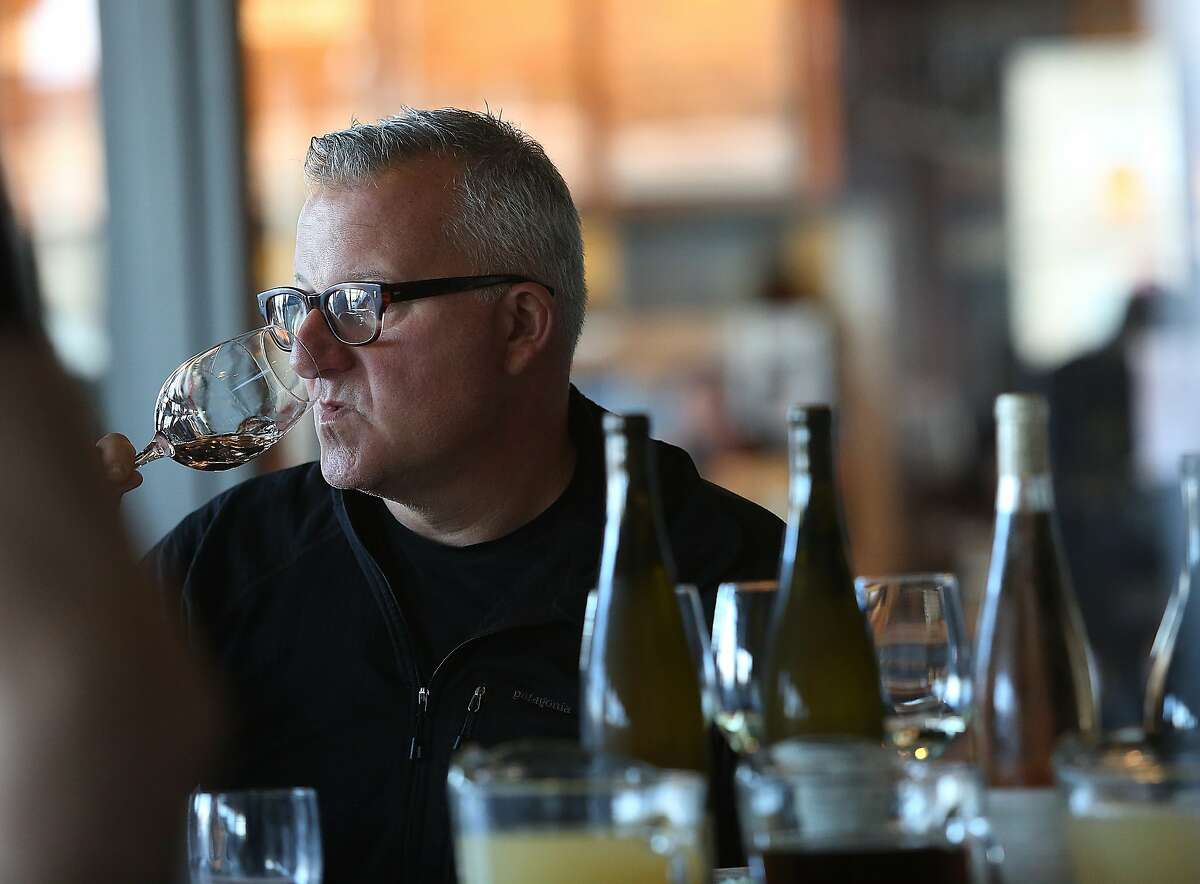 Winemaker Abe Schoener samples at the bar after wine director at The Slanted Door shows her chosen wines (right) in San Francisco, Calif., on Wednesday, October 28, 2015.