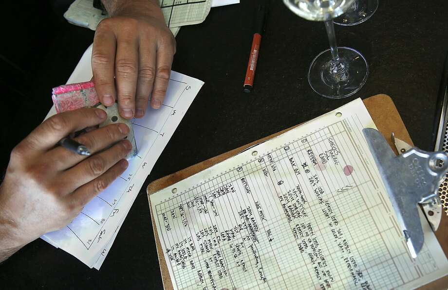 Winemaker Abe Schoener  takes notes at the bar after wine director at The Slanted Door shows her chosen wines in San Francisco, Calif., on Wednesday, October 28, 2015. Photo: Liz Hafalia, The Chronicle