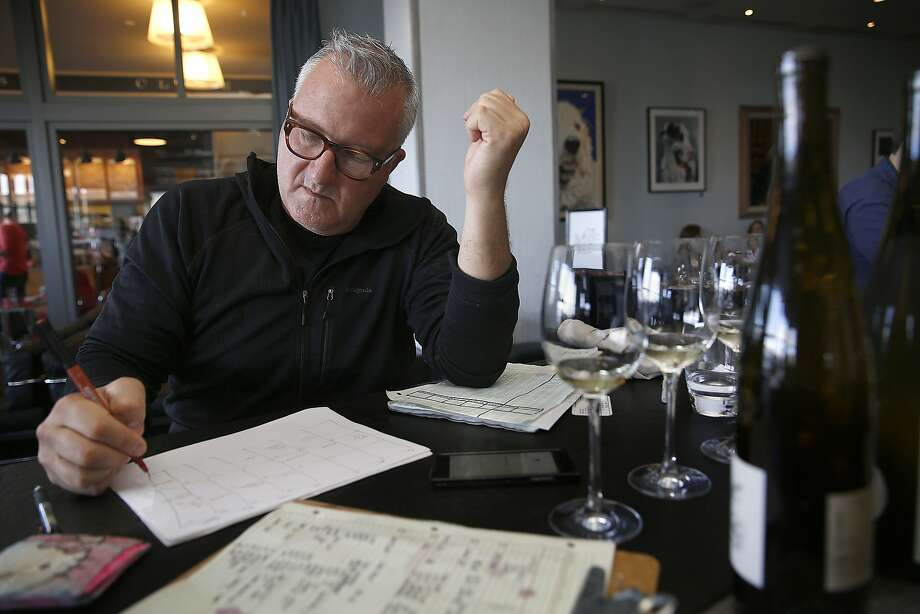 Winemaker Abe Schoener  takes notes at the bar at the Slanted Door. Photo: Liz Hafalia, The Chronicle