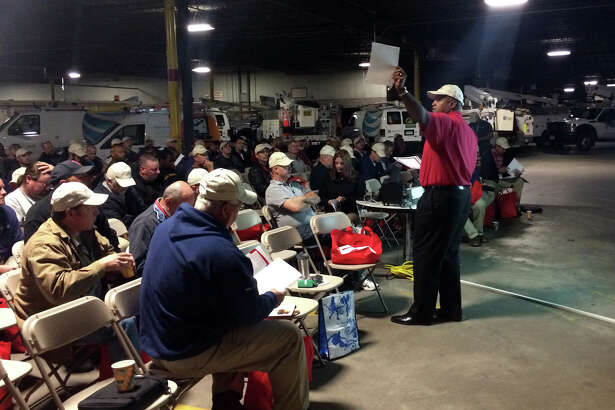 Paul Quick, general manager of Frontier Communications' Connecticut operations, addresses technicians in October 2014 at a company facility in Hartford.