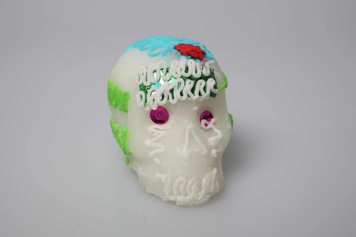 A sugar skull, or calavera, is a traditional part of an altar for Día de los Muertos.