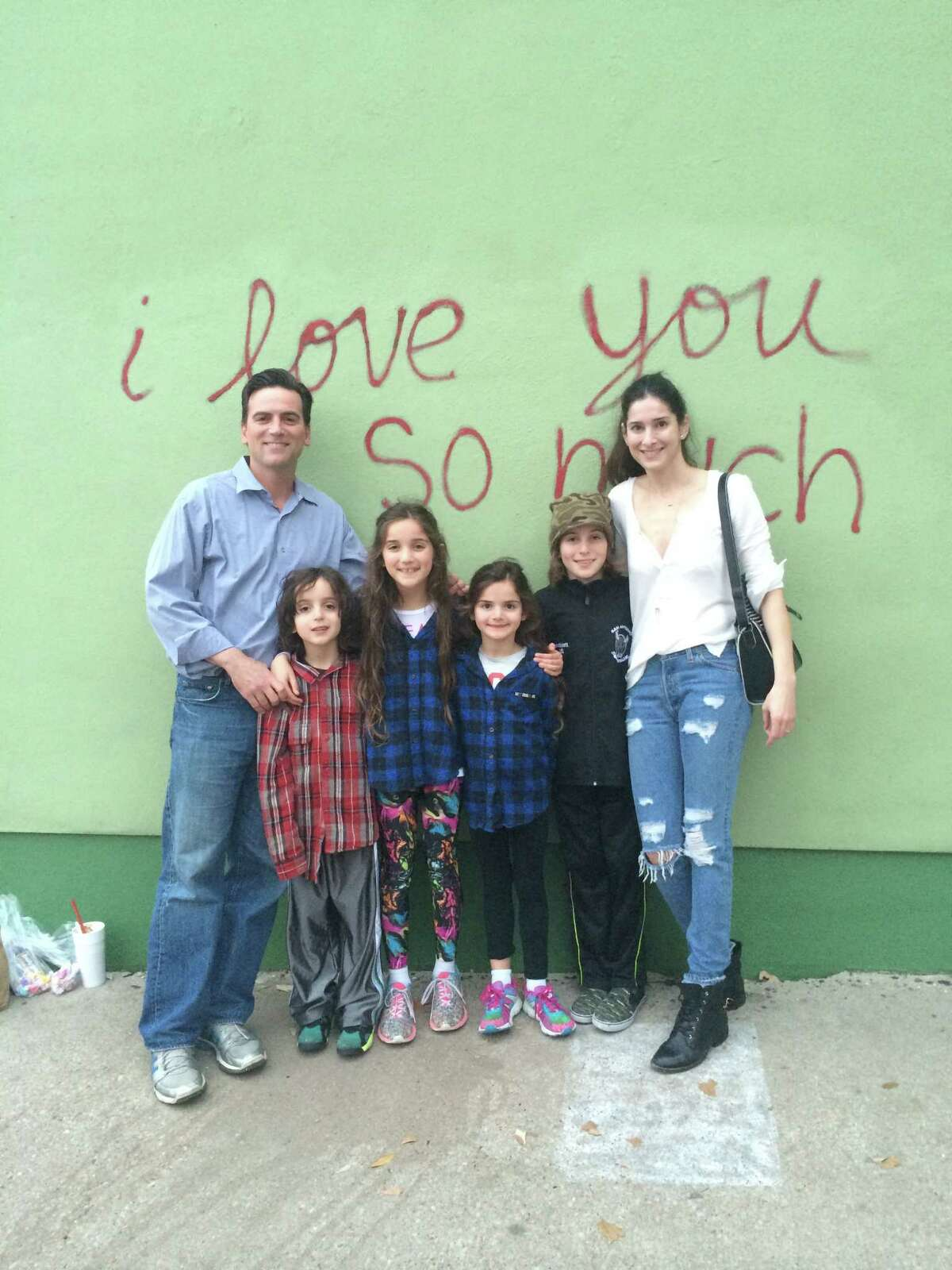 """Jeff Goldblatt, wife, Lori and their four kids -- James, Styra and the twins, Sylvie and Jarett -- enjoyed an outing to Austin's iconic """"I Love You Wall"""" on South Congress. 2014"""