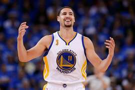 OAKLAND, CA - OCTOBER 27:  Klay Thompson #11 of the Golden State Warriors reacts to a play against the New Orleans Pelicans during the NBA season opener at ORACLE Arena on October 27, 2015 in Oakland, California. NOTE TO USER: User expressly acknowledges and agrees that, by downloading and or using this photograph, User is consenting to the terms and conditions of the Getty Images License Agreement.  (Photo by Ezra Shaw/Getty Images)