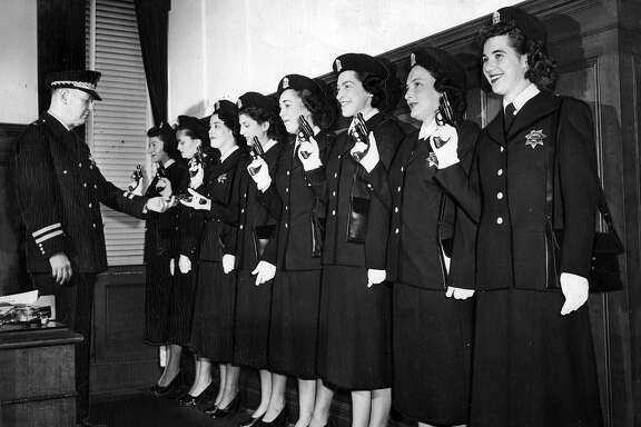 March 16, 1950: Chief Michael Mitchell with a group of female San Francisco Police Department recruits.