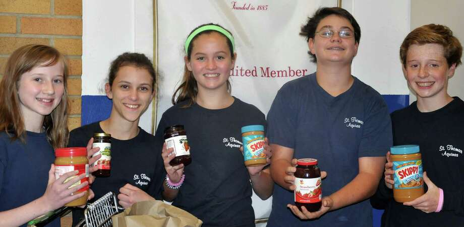 St. Thomas Aquinas Catholic School recently conducted its annual collection of peanut butter and jelly for a Bridgeport food pantry. Students pictured are, from left, Katie Cimmino, Maeva Foley, Eloise Essig, Matt McCauley and Michael Lynch. Photo: Contributed Photo / Fairfield Citizen