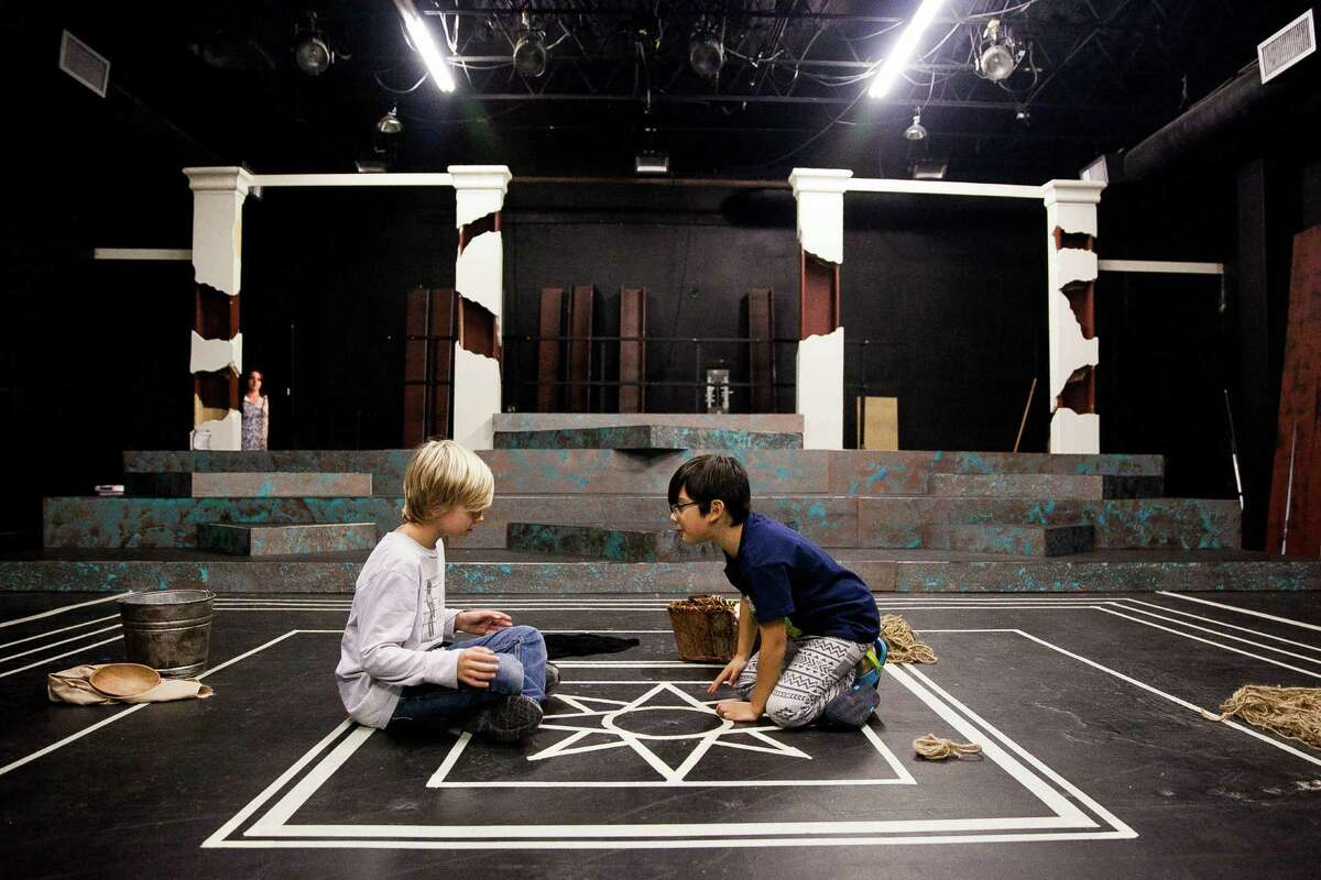 """Jack Tulling, 10, and Logan Trevino, 8, play Medea's doomed sons in Classic Theatre's """"Medea."""""""