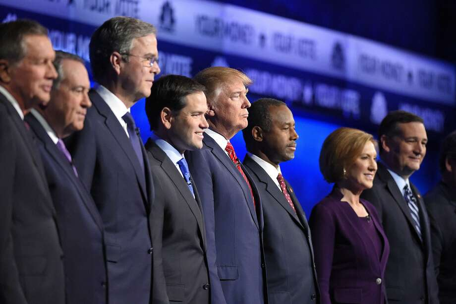 Republican presidential candidates, from left, John Kasich, Mike Huckabee, Jeb Bush, Marco Rubio, Donald Trump, Ben Carson, Carly Fiorina, and Ted Cruz take the stage during the CNBC Republican presidential debate at the University of Colorado, Wednesday, Oct. 28, 2015, in Boulder, Colo. (AP Photo/Mark J. Terrill) Photo: Mark J. Terrill, Associated Press