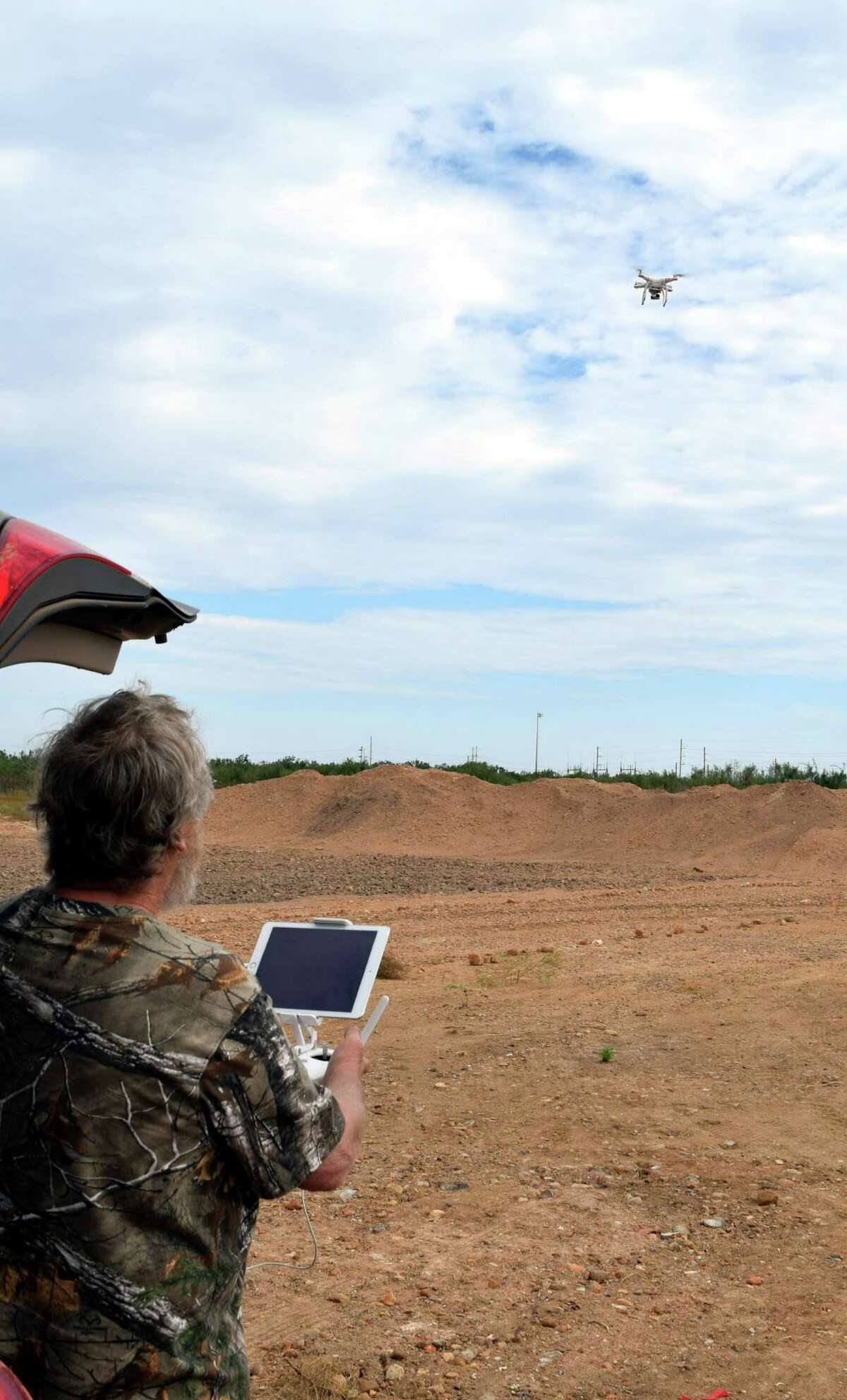Lifting off after being program for a specific flight pattern, this drone being put into use by Jim Raby of San Antonio has helped the hunter use high-tech to help monitor his hunting area.