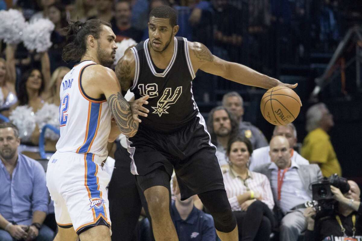 LaMarcus Aldridge of the San Antonio Spurs posts up against Steven Adams of the Oklahoma City Thunder during the first quarter on Oct. 28, 2015 in Oklahoma City.