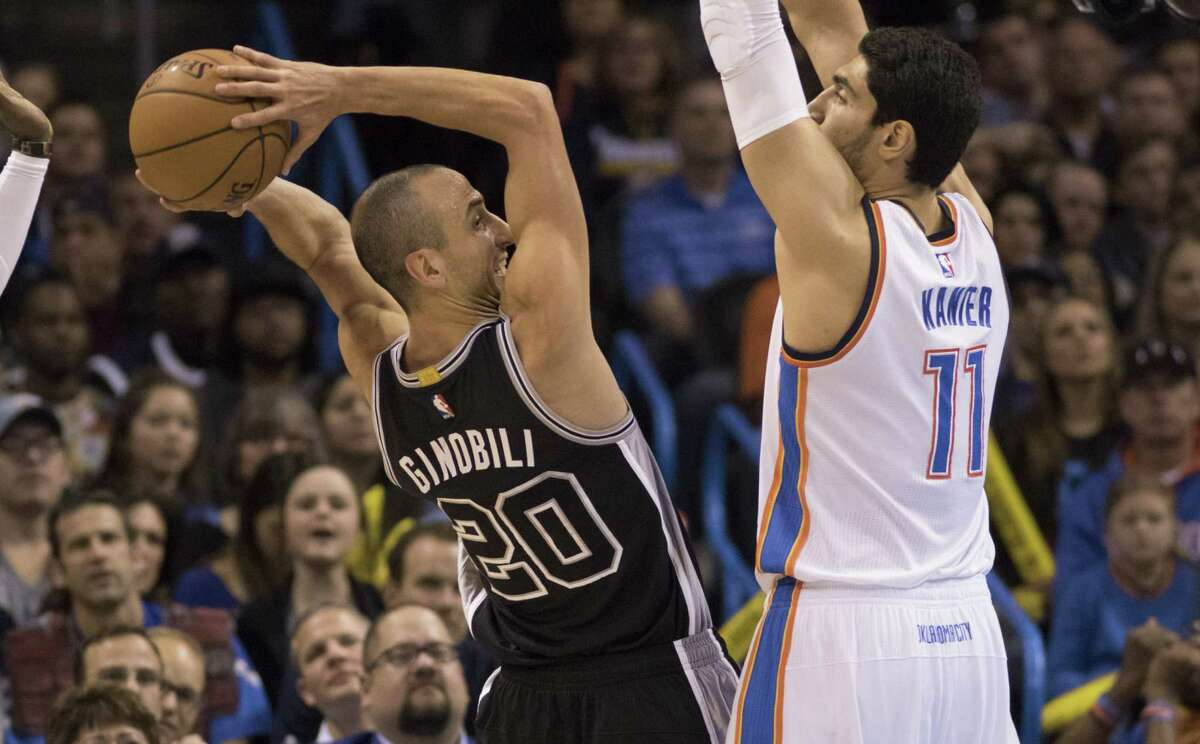 Enes Kanter of the Oklahoma City Thunder guards Manu Ginobili o the San Spurs, forcing him to pass during the first quarter on Oct. 28, 2015.
