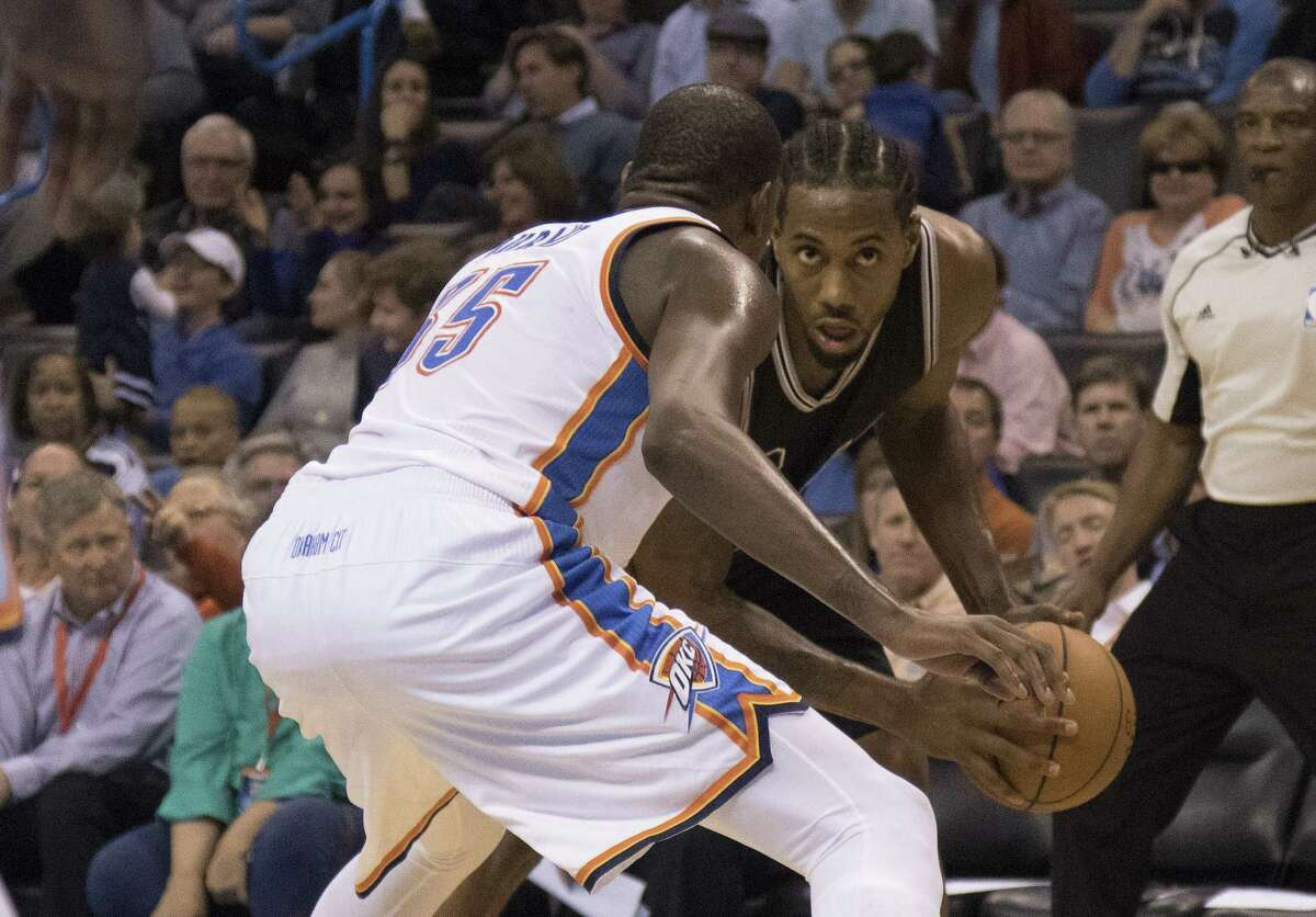 Kevin Durant of the Oklahoma City Thunder guards Kawhi Leonard of the Spurs during the third quarter on Oct. 28, 2015 in Oklahoma City.