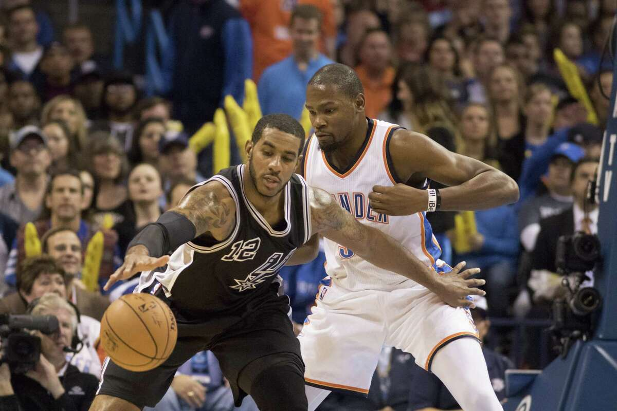 LaMarcus Aldridge of the San Antonio Spurs is defended by Kevin Durant of the Oklahoma City Thunder during the first quarter on Oct. 28, 2015 in Oklahoma City.