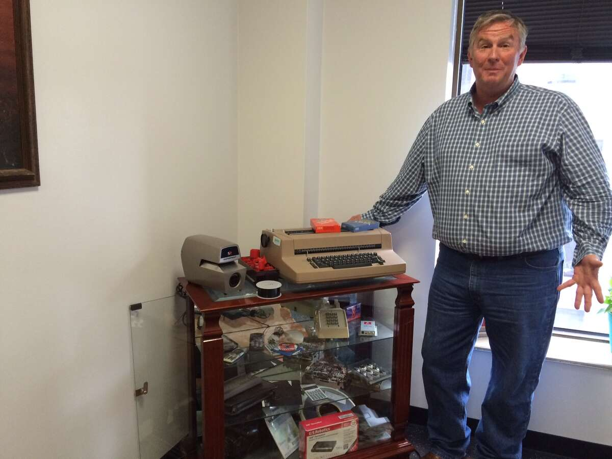 Bruce High, head of Harris County's Central Technology Services, with a shelf of vintage electronic items.
