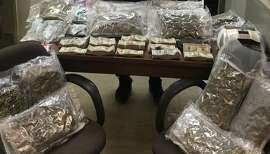 Packaged marijuana and cash sits on a table in New York after the arrest of three men on drug-related charges on Wednesday, Oct. 27, 2015. One of the men is a dentist from San Francisco who marketed his dentistry practice as marijuana-user-friendly.